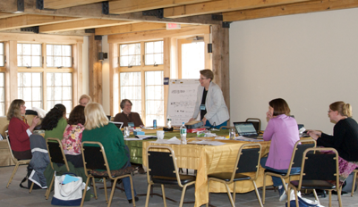 Bobbie Combs speaks to a group of children's writers at a Highlights Foundation workshop.